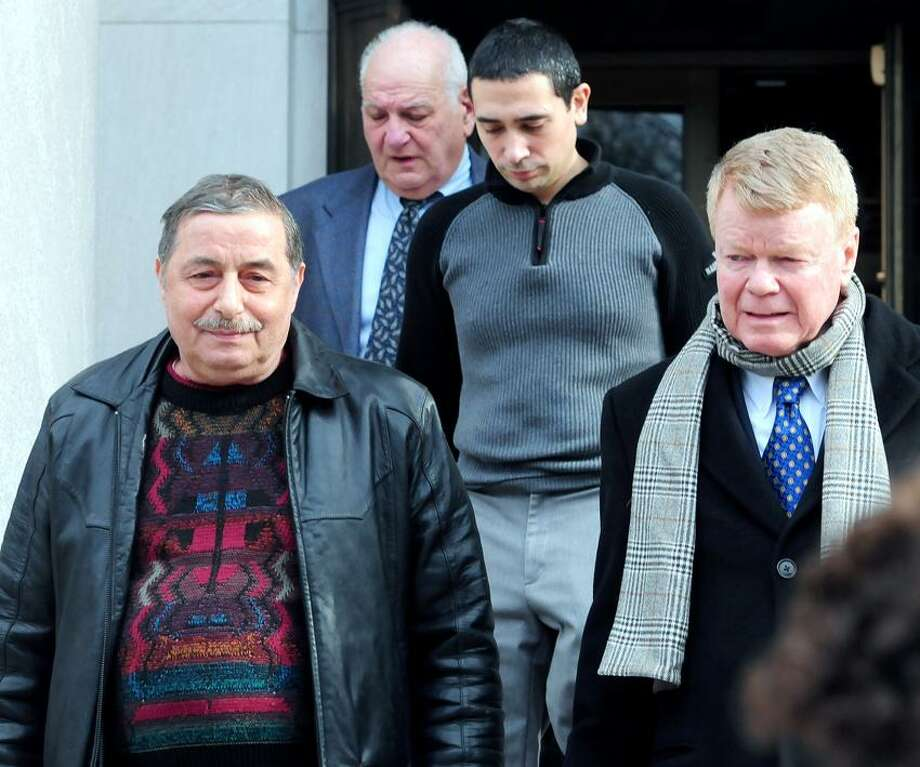 Antonio DiBenedetto, left, owner of Rocco's Bakery, his son, Giovanni, center right, and their attorney, Hugh Keefe, right, leave U.S. District Court in New Haven Thursday. Arnold Gold/Register