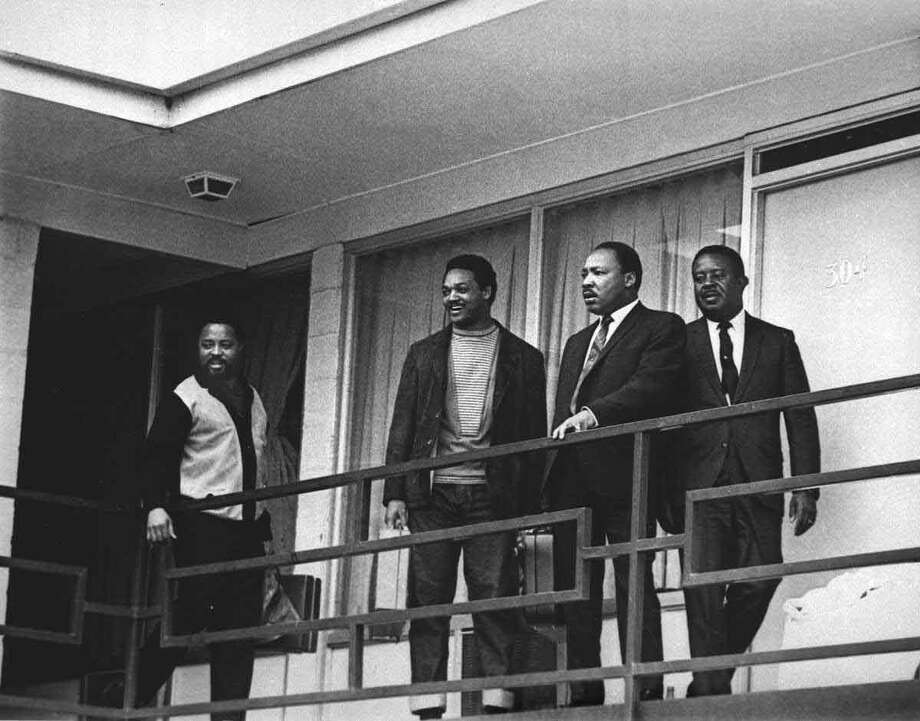 The Rev. Martin Luther King Jr. stands with other civil rights leaders on the balcony of the Lorraine Motel in Memphis, Tenn., on April 3, 1968, a day before he was assassinated at approximately the same place. From left are Hosea Williams, Jesse Jackson, King, and Ralph Abernathy. The 39-year-old Nobel Laureate was the proponent of non-violence in the 1960's American civil rights movement. King is honored with a national U.S. holiday celebrated in January.    Associated Press Photo: AP / 1968 AP