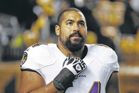 Baltimore Ravens guard John Urschel warms up before an NFL football game against the Pittsburgh Steelers Sunday, Nov. 2, 2014, in Pittsburgh. (AP Photo/Gene J. Puskar)