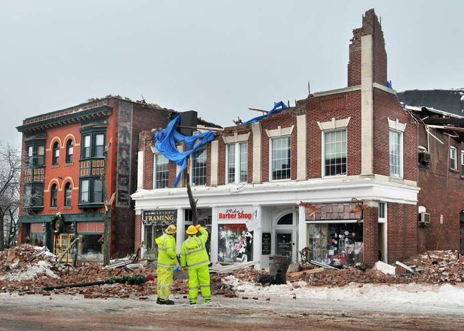 "The Middletown Press  2.4.11  The demolition of the building at 505 Main St. will take place in the next three day.s.The east side of Main St. is open to motorists driving north and south bound,  although there is no parking in that area.  To buy a glossy print of this photo and more, visit <a href=""http://www.middletownpress.com"">www.middletownpress.com</a> / TheMiddletownPress"