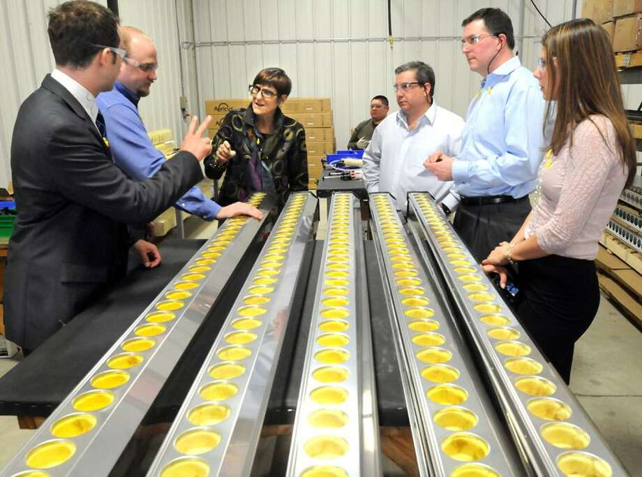 Congresswoman Rosa DeLauro visited Engineering Specialties, Inc. in North Branford to see the manufacture of evacuated tube solar thermal collectors for Apricus, also a North Branford company. Left to right: Apricus Vice President Nigel Ruddell, Apricus engineer Eric Skiba, Rosa, ESI's Vice President Carmen Ciardiello, ESI's President Ronald Delfini, and Apricus marketing person Shannon Horsley. Mara Lavitt/New Haven Register