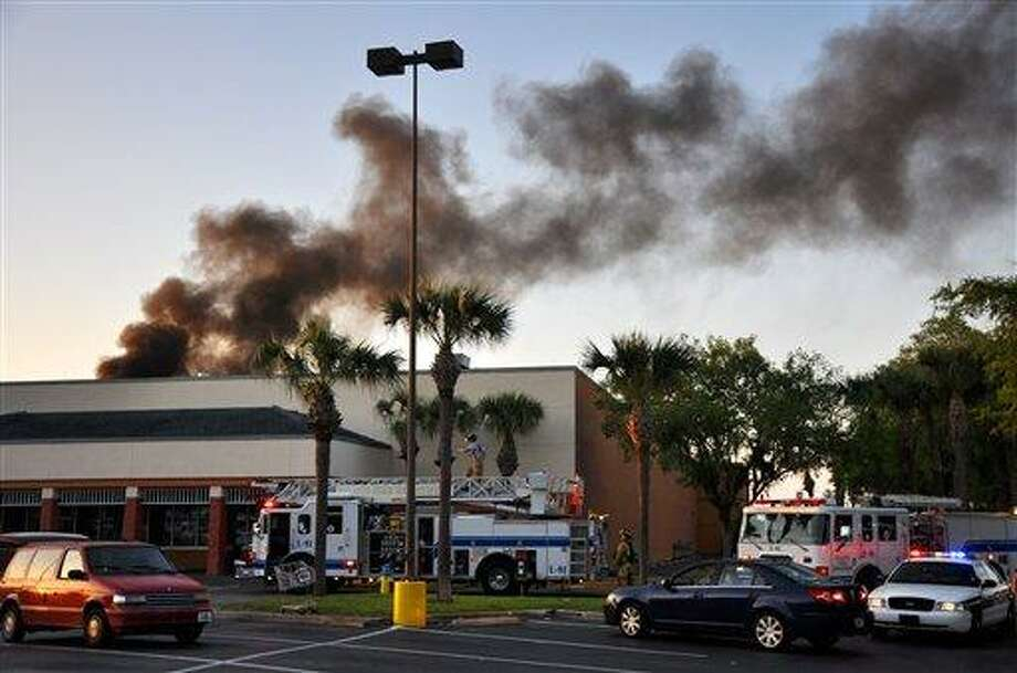 First responders from DeLand Fire Department, Volusia County Fire Services, EVAC and DeLand Police Department work the scene of a small plane crash Monday at the Publix Supermarket on East International Speedway Boulevard, in DeLand, Fla. Associated Press Photo: AP / Daytona Beach News-Journal
