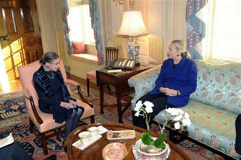 This photo, released by the State Department, shows Secretary of State Hillary Rodham Clinton meeting with Supreme Court Justice Ruth Bader Ginsburg at the State Department in Washington Jan. 25, before Ginsburg left for two North African countries where popular uprisings helped topple longtime leaders.  Associated Press Photo: AP / State Department