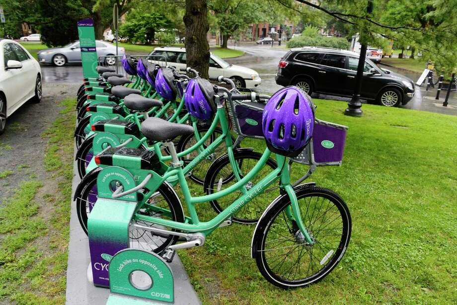 Bicycles are lined up at the CDPHP Cycle! station in Washington Park on the eve of the bicycle sharing program's launch by CDTA last month. (Paul Buckowski / Times Union) Photo: PAUL BUCKOWSKI / 20041142A