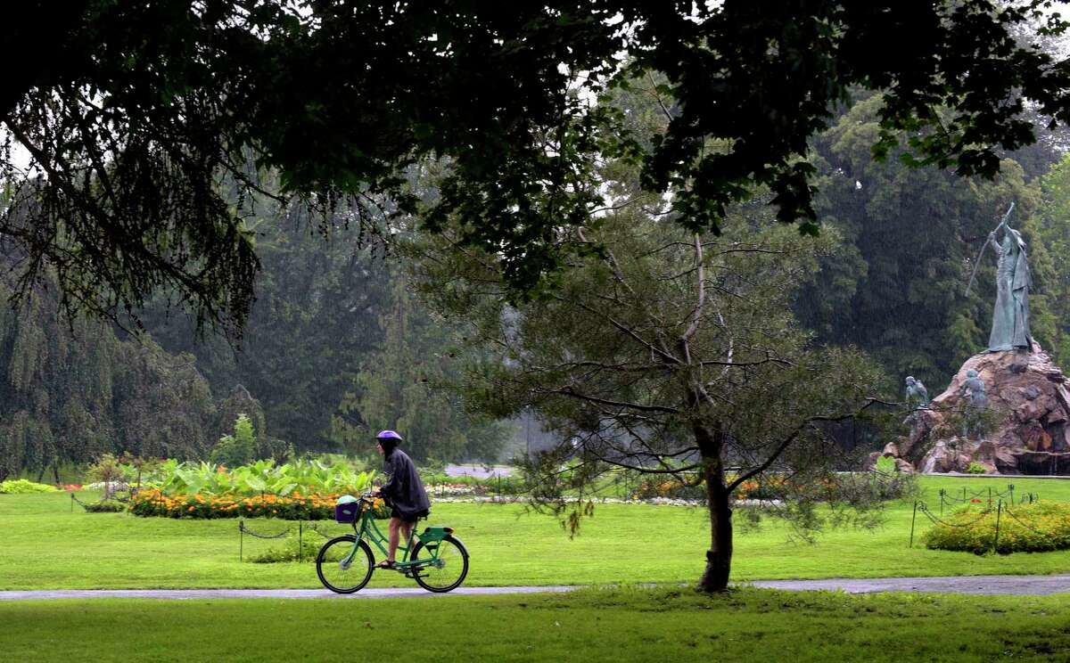 A woman rides one of the CDPHP Cycle! bikes that are part of the newly launched bike share program through Washington Park on Thursday, July 27, 2017, in Albany, N.Y. (Paul Buckowski / Times Union)