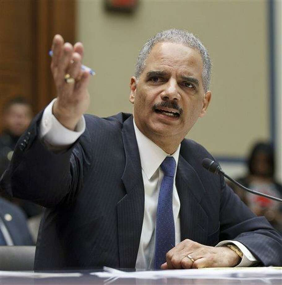 Attorney General Eric Holder testifies on Capitol Hill in Washington today before the House Oversight and Government Reform Committee. Associated Press Photo: AP / AP