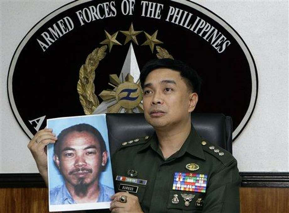 Armed Forces of the Philippines spokesman Col. Marcelo Burgos shows a picture of Malaysian Zulkipli bin Hir, also known as Marwan, a top leader of the regional, al Qaida-linked Jemaah Islamiyah terror network, during a press conference today in suburban Quezon City, north of Manila, Philippines. The military said it killed Southeast Asia's most-wanted terrorist and two other senior militants in a U.S.-backed airstrike that would mark one of the region's biggest anti-terror successes in recent years.  Associated Press Photo: AP / AP