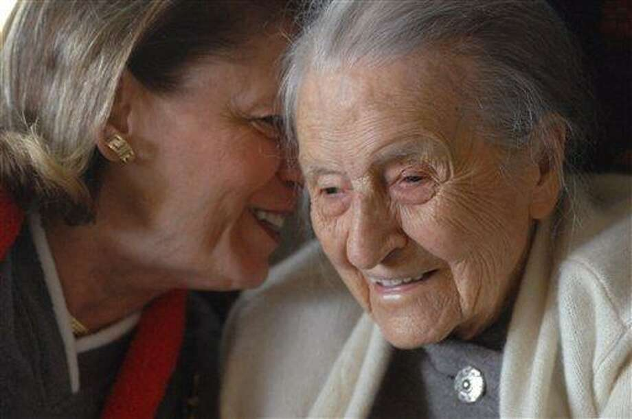 In a 2008 photo, Dr. Leila Denmark, right, listens to her grand niece Jackie Bennett as she celebrates her 110th birthday, in Athens, Ga. Family members say Denmark, who was the world's oldest practicing physician when she retired at age 103, died Sunday in Athens, Ga. She was 114. Associated Press Photo: AP / Associated Press