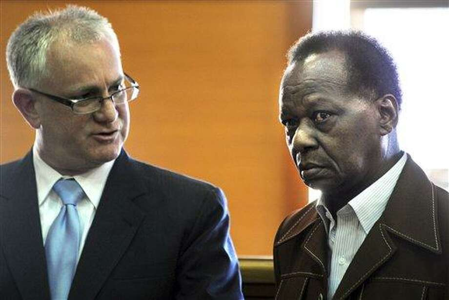 Onyango Obama, uncle of President Barack Obama, right, stands March 27 with his attorney, F. Scott Bratton in Framingham, Mass., District Court. Associated Press Photo: AP / MetroWest Daily News
