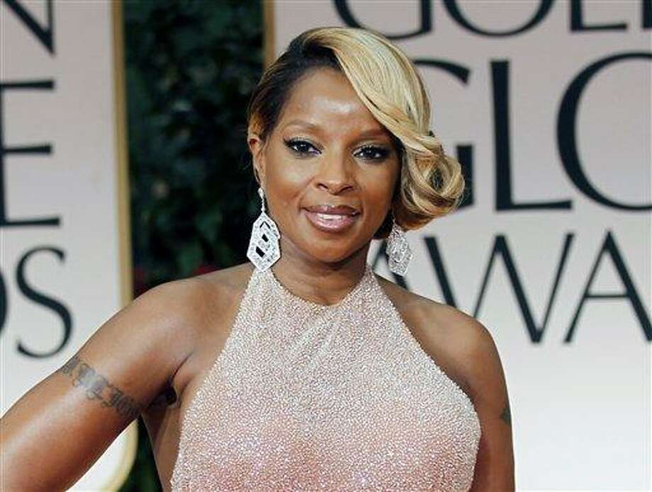 """FILE - In this Jan. 15, 2012 file photo, singer Mary J. Blige arrives at the 69th Annual Golden Globe Awards in Los Angeles. A criticized Burger King commercial featuring Mary J. Blige singing about chicken has been pulled, but the fast-food chain is blaming licensing issues for the decision. In it, Blige sings passionately about the ingredients in the chicken snack wraps. But as the video went viral, some in the black community criticized the ad as stereotypical. The black women-oriented website Madame Noire likened it to """"buffoonery."""" Burger King said Tuesday the commercial was pulled because of a music licensing concern and that they hope to have the Blige """"ads back on the air soon."""" (AP Photo/Matt Sayles, file) Photo: AP / AP2012"""