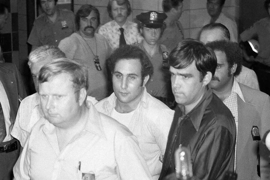 """Serial killer David Berkowitz, known as """"Son of Sam,"""" arrives at Brooklyn Courthouse after his arrest in August 1977. Photo: Ira Schwarz, Associated Press"""