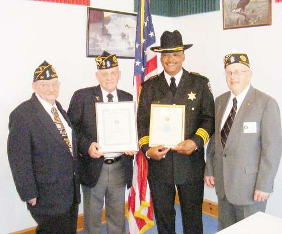 Photo Courtesy MUNNSVILLE AMERICAN LEGION From left are John Graham, commander Munnsville American Legion; Carl Griffith standing in for Todd Collins, Munnsville Fire Chief and Wendy Kiehn, firefighter/EMT; Madison County Sheriff Allen Riley; and Joe Barilla Sr., Madison County American Legion commander.