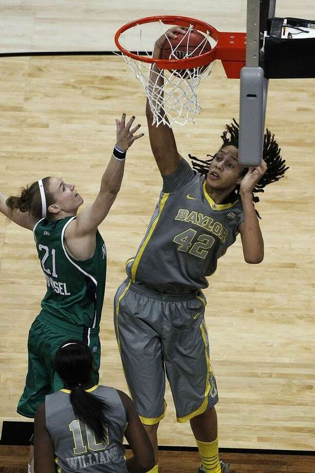 Baylor center Brittney Griner (42) pulls  a rebound away from Notre Dame guard Natalie Novosel (21) during the first half in the NCAA women's Final Four college basketball championship game, in Denver, Tuesday, April 3, 2012.  (AP Photo/David Zalubowski) Photo: ASSOCIATED PRESS / AP2012