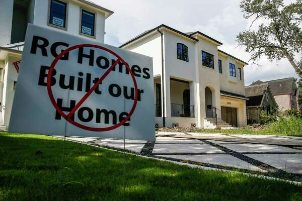 Signs warning about custom home builder RG Homes sit outside of a house that homeowners say leaked, cracked and was poorly built Thursday, July 27, 2017 in Bellaire. ( Michael Ciaglo / Houston Chronicle )