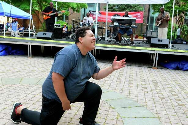 Patrick Brandao, of Bridgeport, dances to a Michael Jackson song performed by the Sez Zion Jazz Band during Downtown Thursdays Concert Series at McLevy Green in downtown Bridgeport, Conn., on Thursday July 27, 2017. The Sez Zion Jazz Band, from Bridgeport, formed in 2001.