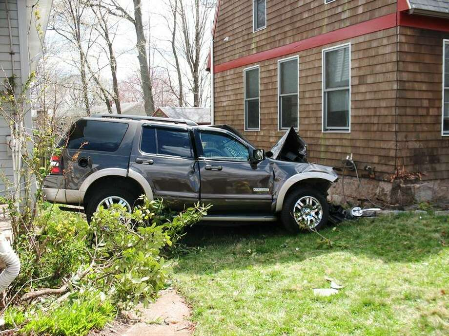 This SUV crashed into East Haven home Monday. Photo courtesy East Haven Fire Department.
