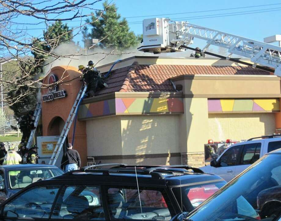 Firefighters battle fire at Taco Bell. Patricia Villers/Register.