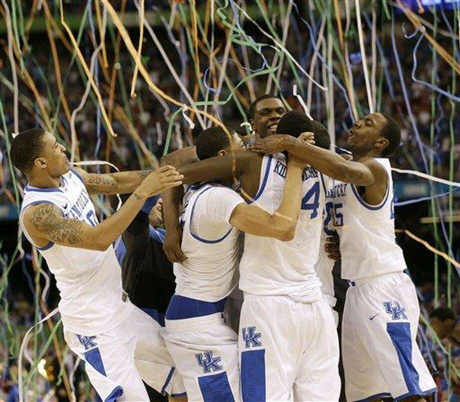 Kentucky players celebrate at the end of the NCAA Final Four tournament college basketball championship game against Kansas Monday, April 2, 2012, in New Orleans. Kentucky won 67-59. (AP Photo/David J. Phillip) Photo: ASSOCIATED PRESS / AP2012