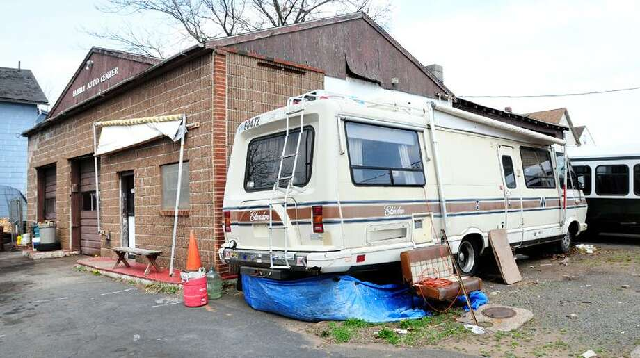 A neglected property on the corner of Shelton Avenue and Goodrich Street in Hamden. Photo by Arnold Gold/Register