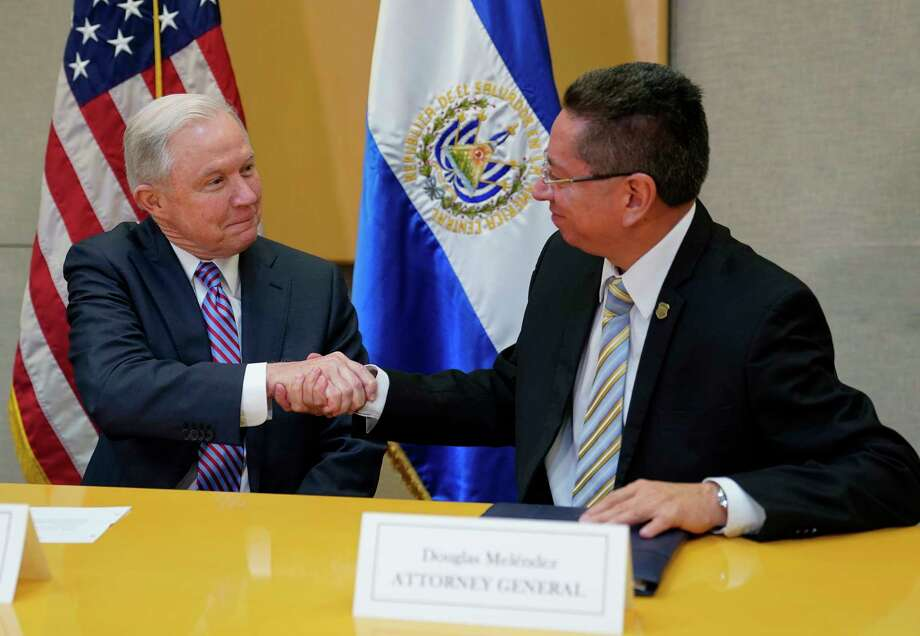 U.S. Attorney General Jeff Sessions shakes hands with El Salvador Attorney General Douglas Melendez Ruiz during their meeting in San Salvador, El Salvador, Thursday, July 27, 2017.  (AP Photo/Pablo Martinez Monsivais) ORG XMIT: SLVM115 Photo: Pablo Martinez Monsivais / Copyright 2017 The Associated Press. All rights reserved.