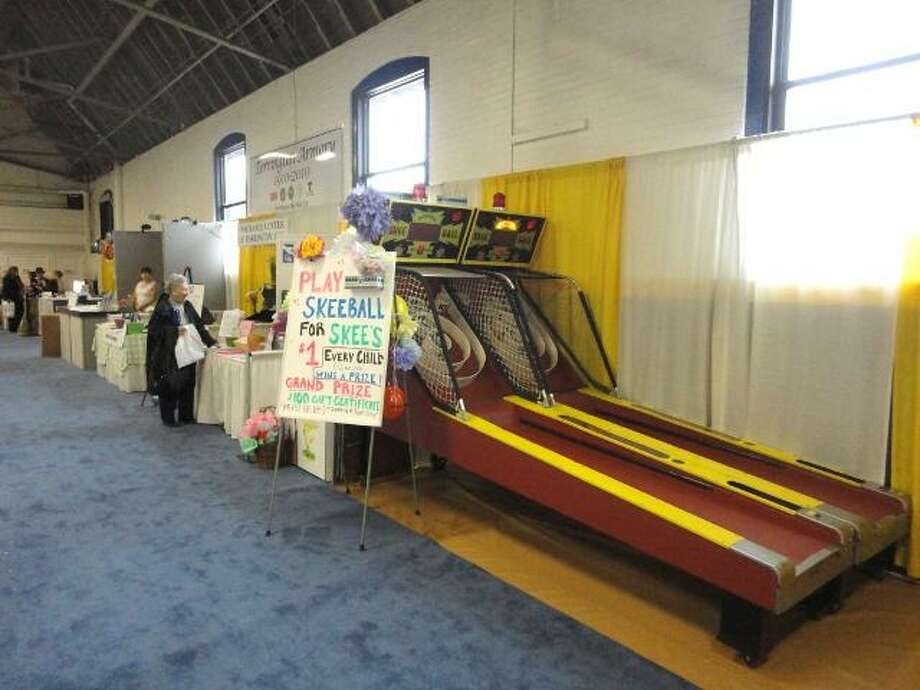 "JASON SIEDZIK/ Register Citizen The Northwest Connecticut Chamber of Commerce set up a pair of Skee-Ball machines at their home and business expo on Sunday. The games will help raise funds to preserve Skee's Diner. To purchase a glossy photo of this picture, visit <a href=""http://registercitizen.com"">registercitizen.com</a>."
