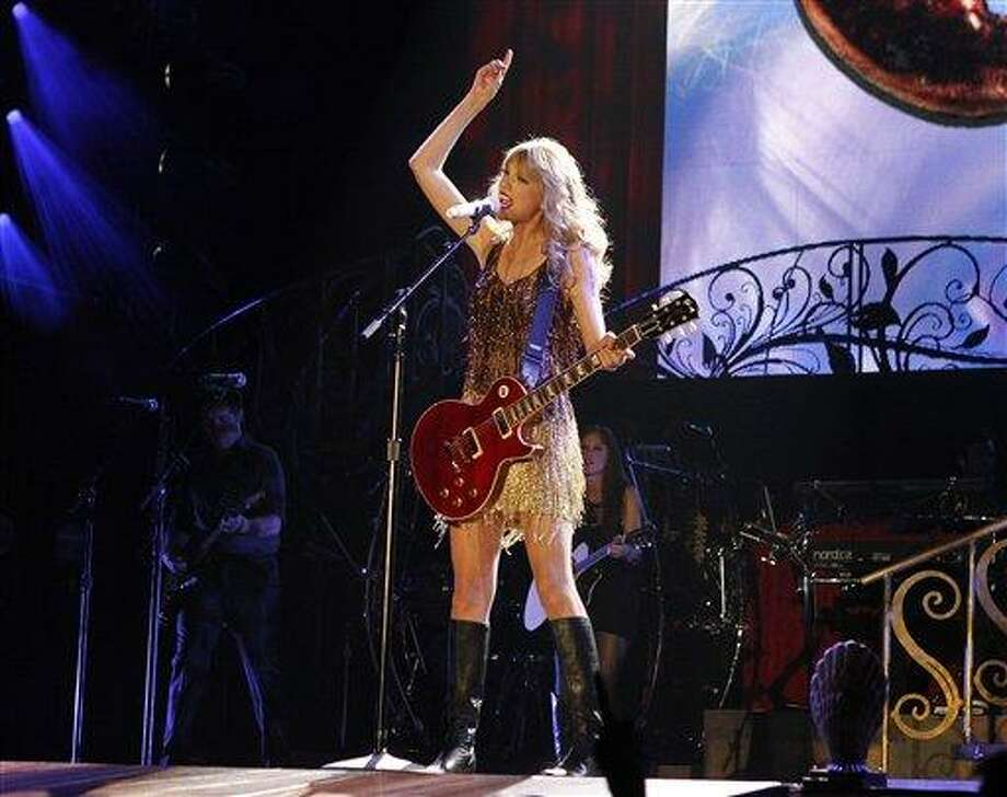 """Taylor Swift performs on stage at the Burswood Dome during the opening night of her """"Speak Now"""" Australian tour in Perth, Australia, Friday, March 2, 2012. The American country singer will perform in Perth, Adelaide, Brisbane, Sydney, Melbourne and Auckland New Zealand. Photo: ASSOCIATED PRESS / AP2012"""