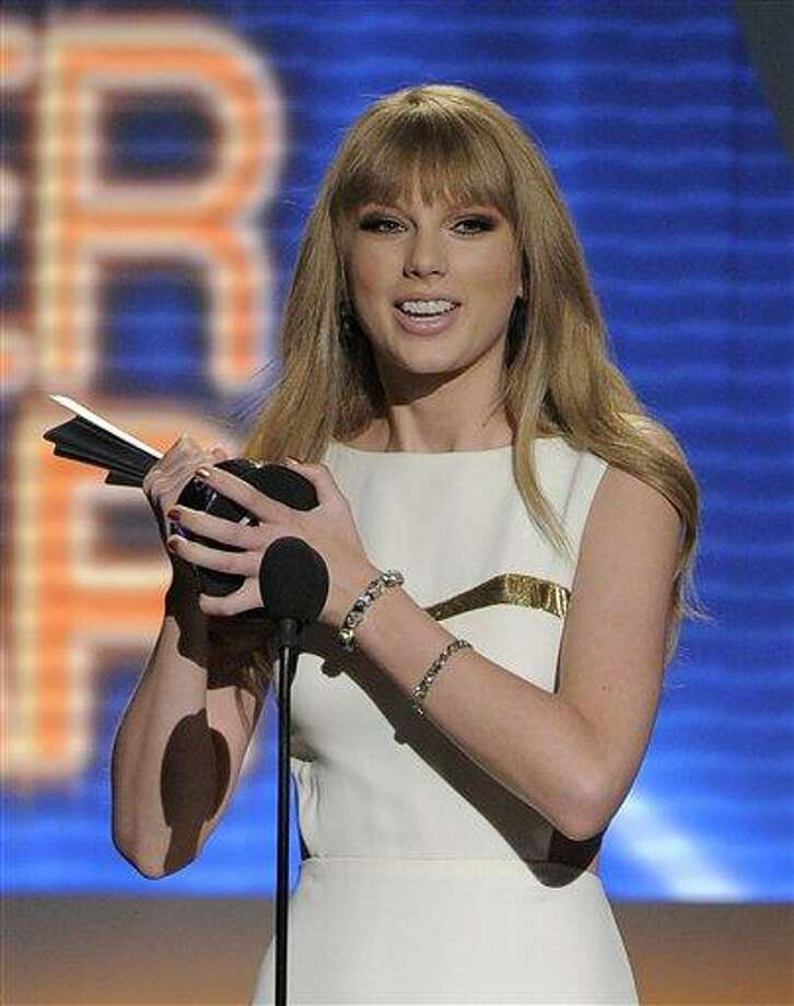 Taylor Swift accepts the award for entertainer of the year at the 47th Annual Academy of Country Music Awards on Sunday in Las Vegas. Associated Press Photo: AP / AP