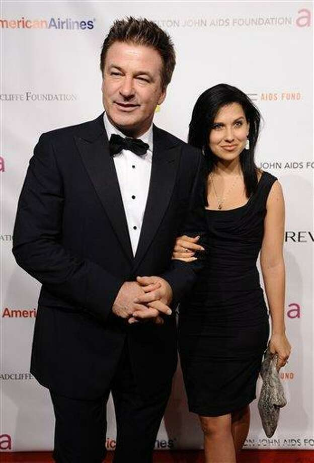 Actor Alec Baldwin, left, and Hilaria Thomas attend the Elton John AIDS Foundation 10th Annual Enduring Vision Benefit in New York in 2011. Baldwin proposed to Thomas over the weekend. They began dating last year. Baldwin was married once before to actress Kim Basinger. Associated Press Photo: AP / AP2011