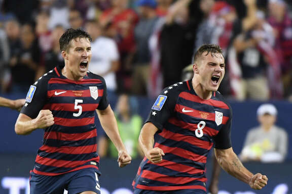 Jordan Morris (8) leads the charge after scoring the game-winning goal in the United States' 2-1 victory over Jamaica in the Gold Cup final Wednesday night.