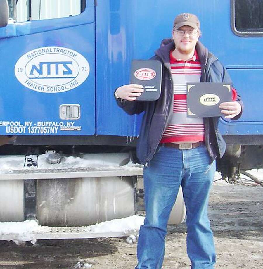 Photo Courtesy Michael Potanovich Michael Potanovich poses with his National Tractor Trailer School certification and license.