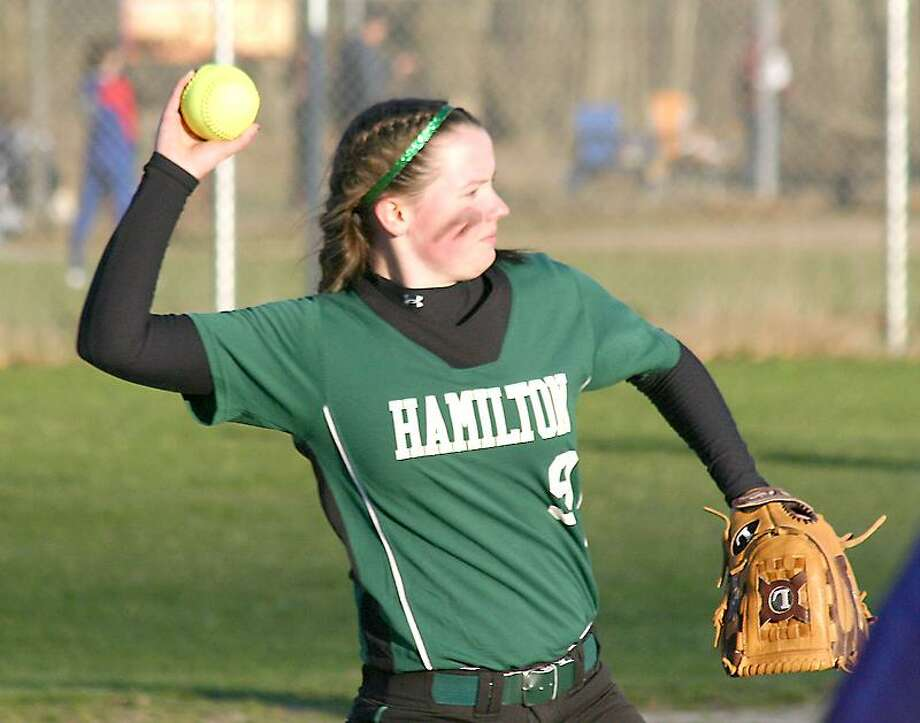 Submitted Photo by JON RATHBUN  Hamilton pitcher Becca Rogers throws to first base in a game against Little Falls Monday.