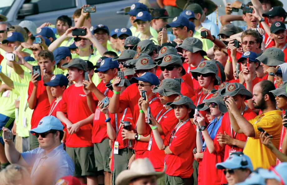 Scouts and their leaders listen to President Donald Trump at the 2017 National Boy Scout Jamboree at the Summit in Glen Jean, W.Va., Monday, July 24, 2017. (AP Photo/Steve Helber) ORG XMIT: WVSH111 Photo: Steve Helber / Copyright 2017 The Associated Press. All rights reserved.