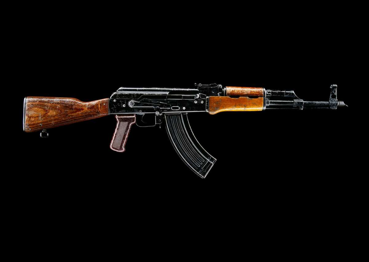 A stock image showing the side view of AK-47 rifle.