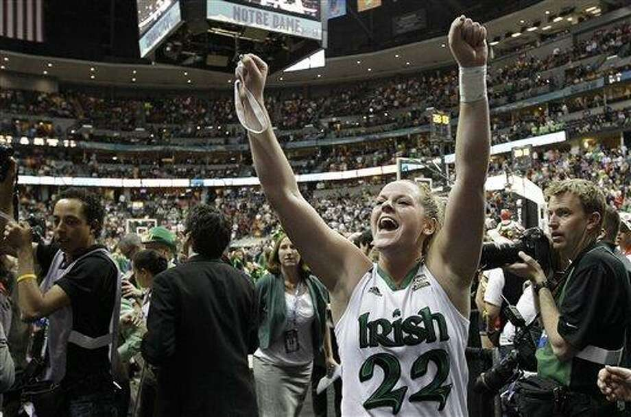 Notre Dame guard Brittany Mallory (22) celebrates victory after an NCAA women's Final Four semifinal college basketball game against Connecticut in Denver, Sunday, April 1, 2012. Notre Dame won 83-75. (AP Photo/Eric Gay) Photo: ASSOCIATED PRESS / AP2012