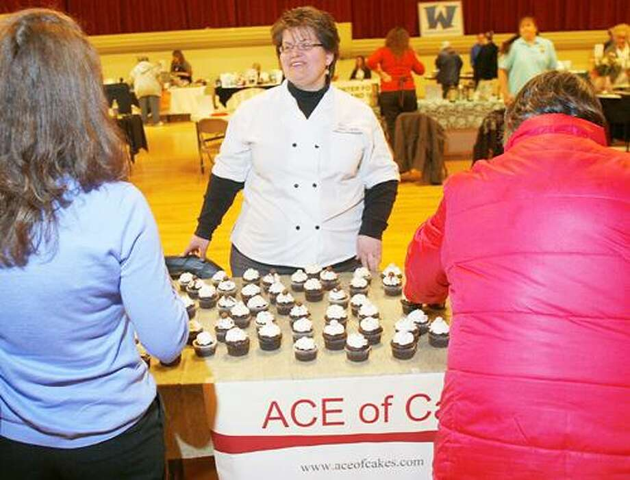 Photo by JOHN HAEGER (Twitter.com/OneidaPhoto) Gail Garrison of Ace of Cakes talks about her business during the Oneida's Downtown Association's Business Expo and Job Fair at the Kallet on Saturday, March 31, 2012.