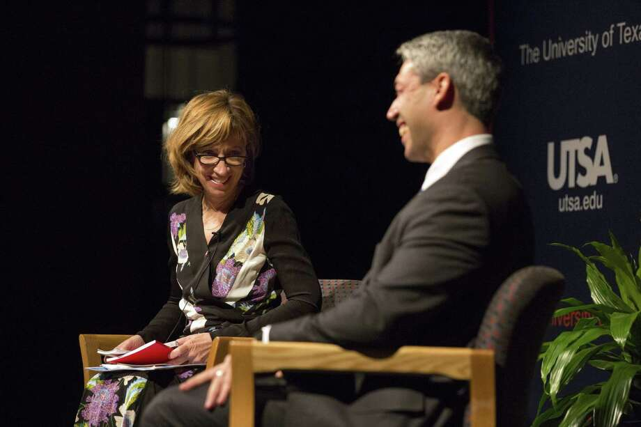 Moderator Francine S. Romero shares a laugh with Mayor Ron Nirenberg during a town hall Thursday at UTSA's downtown campus. Photo: Ray Whitehouse /For The San Antonio Express-News