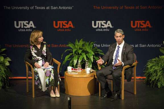 Mayor Ron Nirenberg speaks with moderator Francine S. Romero, associate dean for the university's college of public policy, at Thursday's town hall.