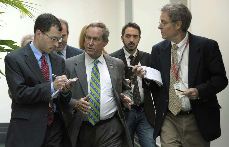 Rep. Joe Wilson, R-S.C., is followed by reporters after leaving a caucus meeting on Capitol Hill in Washington, Friday, July 29, 2011. (AP Photo/Susan Walsh) Photo: AP / AP