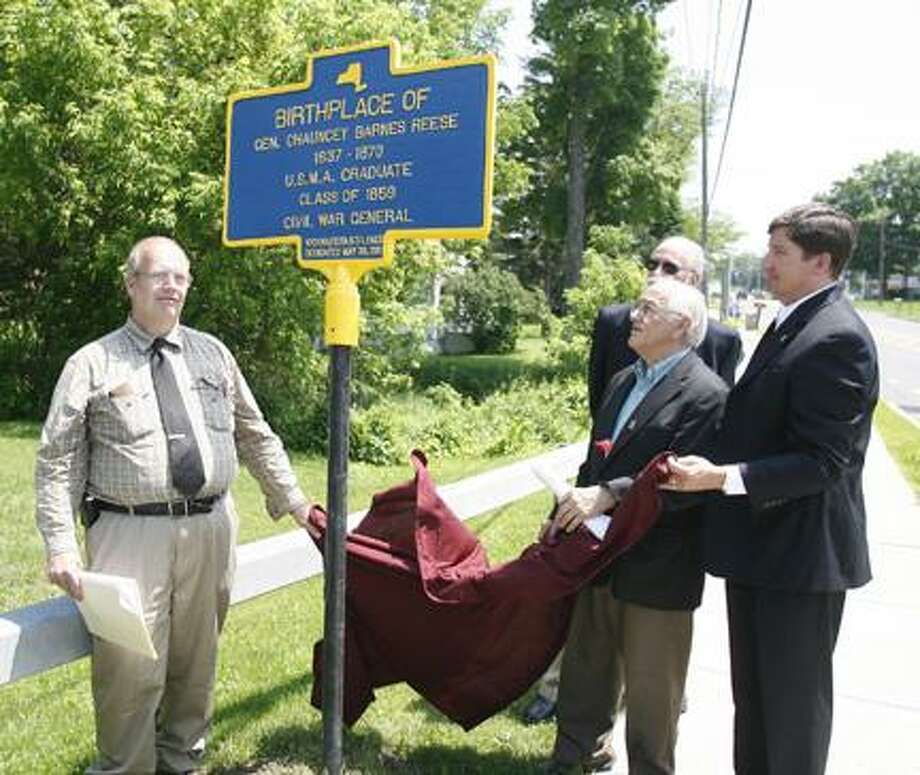 Dispatch Staff Photo by JOHN HAEGRVillage of Canastota Historian David Sadler, Town of Lenox Supervisor Rocco J. DiVeronica, Village of Canastota Mayor Todd Rouse and New York State Historian Robert Weible unveil a marker noting the birthplace of Civil War General Chauncey Barnes Reese on Monday, May 30, 2011 on Route 5 in the Village of Canastota.