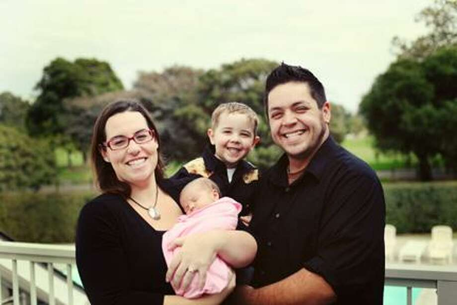 Submitted Photo Tony and Sara Beth Paredes with their children, Ethan and Ellie.