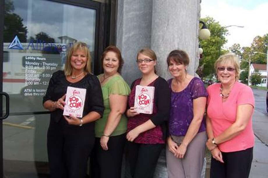 """Photo courtesy Constance Mente Alliance Bank Branch Manager Doreen Borders, left, with staff members Sherrie Convertino, Rachel McDaniel, Roxann Jeffers and Darcy Bendura. The children's series kicks off at the Hamilton Theater Saturday, Oct. 8 with """"Rio"""" and a visit from the Utica Zoomobile."""