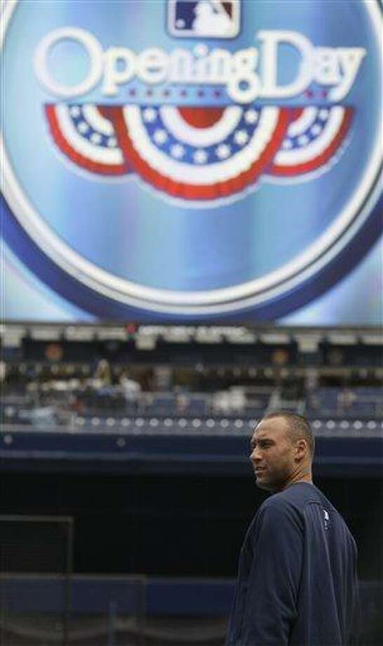 New York Yankees' Derek Jeter looks on during a practice at Yankee Stadium Wednesday, March 30, 2011  in New York. The Yankees open the season on Thursday, March 31, when they host the Detroit Tigers. (AP Photo/Frank Franklin II) Photo: AP / AP