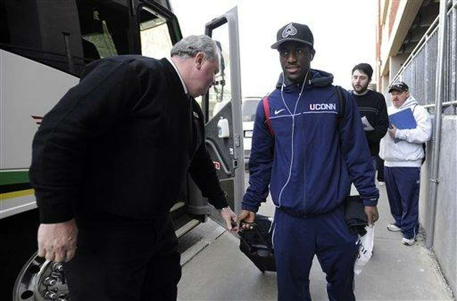 Connecticut's Kemba Walker boards a bus on campus bound for the airport in Storrs, Conn., en route to Houston, Wednesday, March 30, 2011.  Connecticut will face Kentucky in NCAA Final Four Game in Houston Saturday.  (AP Photo/Jessica Hill) Photo: AP / AP2011