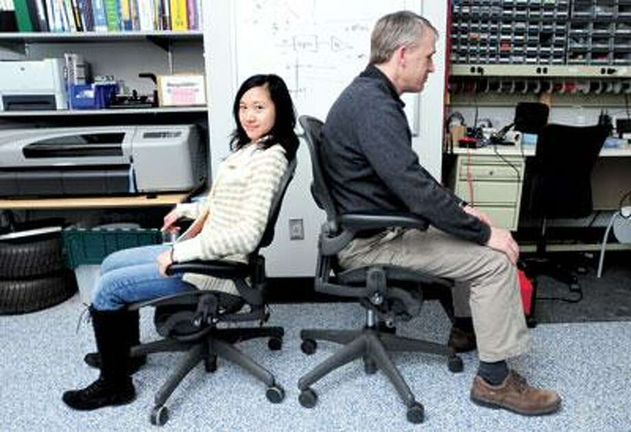 "In the Human-Machine Interface Laboratory at Yale, doctoral student Ying ""Jean"" Zheng worked with her adviser, professor John Morrell, on the Vibrotactile Posture Feedback Chair. (Arnold Gold/Register)"