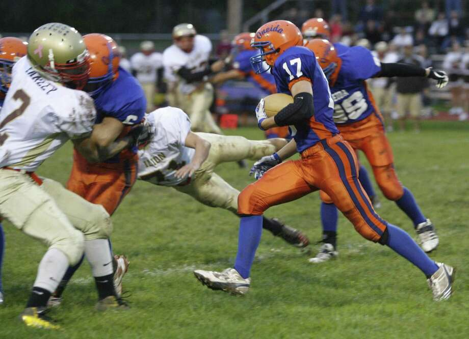 """Dispatch Staff Photo by JOHN HAEGER <a href=""""http://twitter.com/oneidaphoto"""">twitter.com/oneidaphoto</a> Oneida's Justin Klossner (17) looks for room to run on the kickoff return in the first half of the game against Ilion in Oneida on Friday Sept. 30, 2011."""