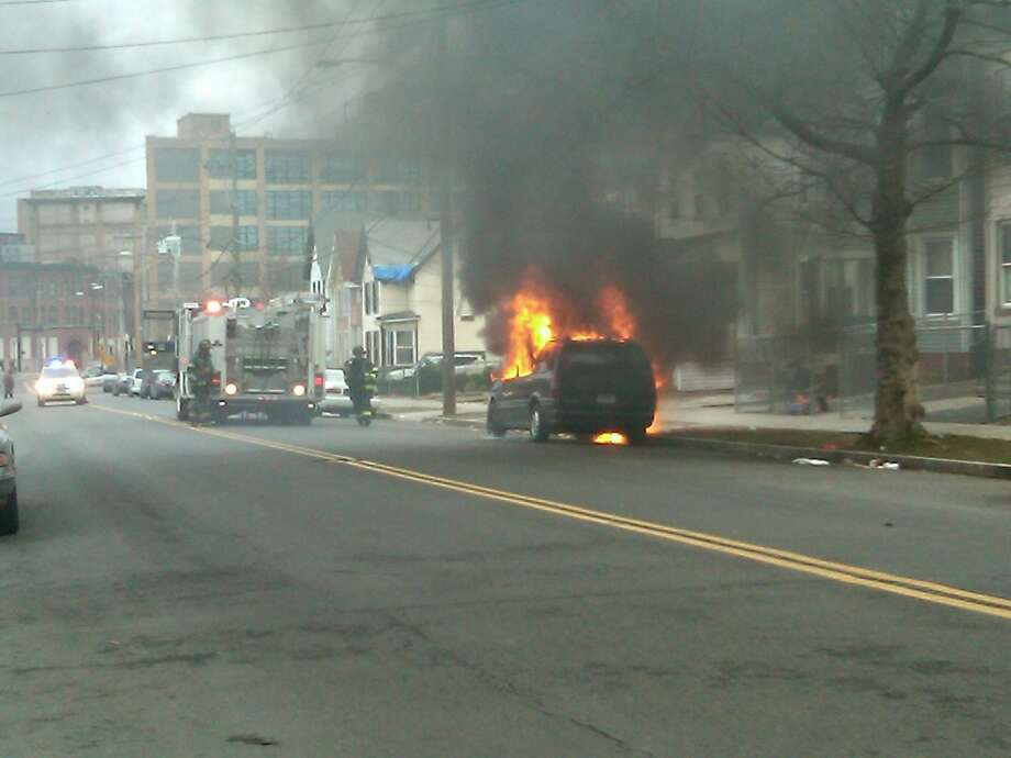 A minivan caught fire on Henry Street Thursday, the Fire Department put it out   Photo by William Kaempffer