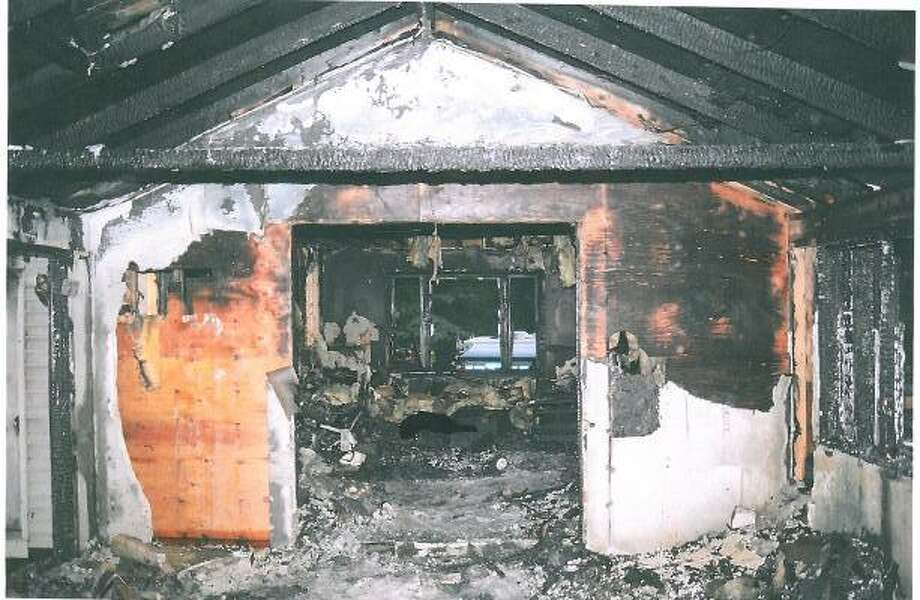 An evidence photo shows a burned portion of the Petit house after the fire on July 23, 2007.