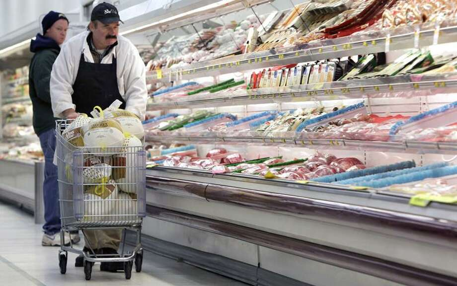 Meat Manager Dennis Sheehan could soon be stocking shelves at Pixley's Shurfine grocery store in Akron, N.Y., with horse meat instead turkeys and beef. (Associated Press) Photo: AP / AP2011