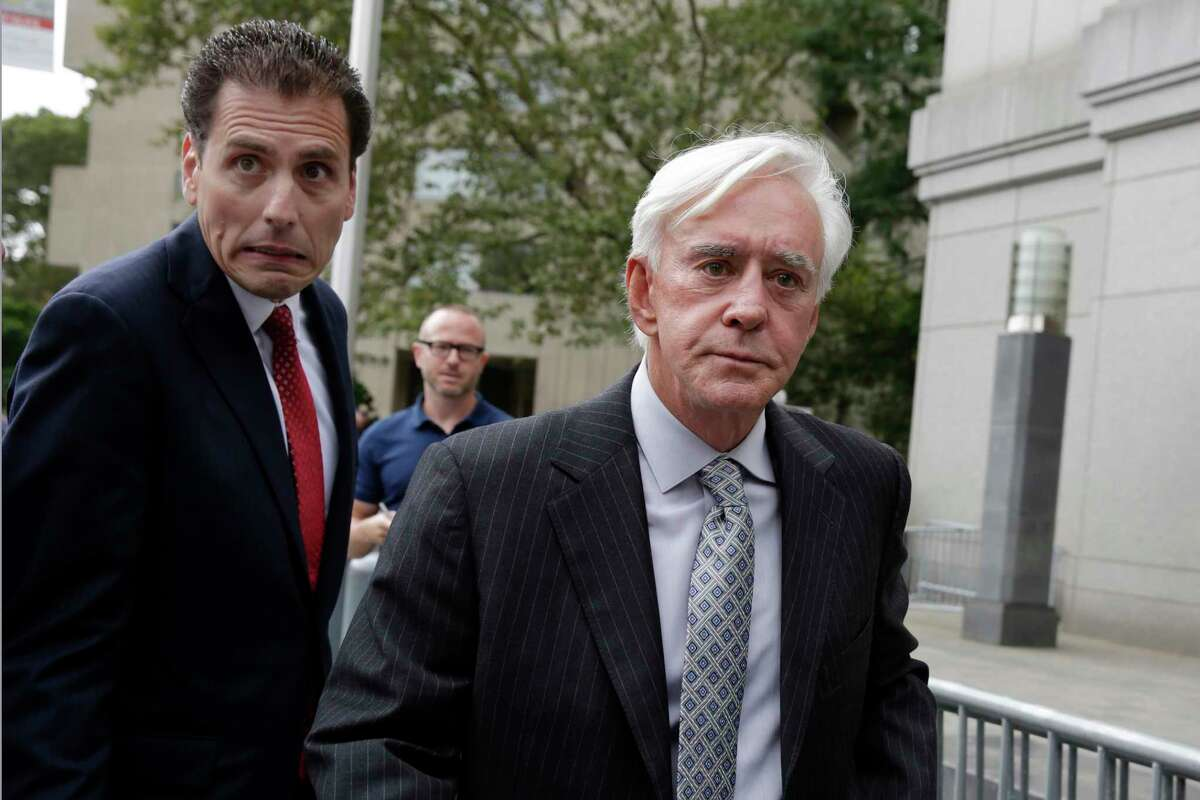 """Las Vegas gambler William """"Billy"""" Walters, right, accompanied by one of his attorneys, leaves Manhattan federal court, in New York, Thursday, July 27, 2017. Walters, linked to golfer Phil Mickelson, was sentenced to five years in prison for his conviction on insider trading charges.(AP Photo/Richard Drew)"""