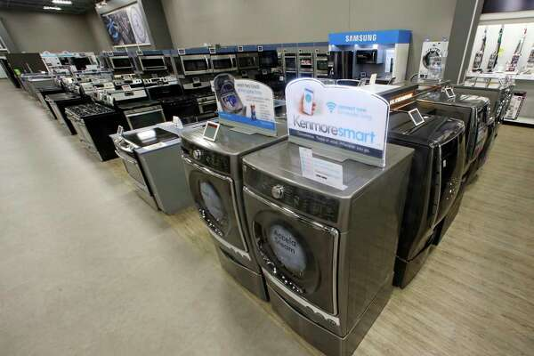 Kenmore washers and dryers are displayed at a Sears in West Jordan, Utah. Orders for durable goods climbed 6.5 percent in June.